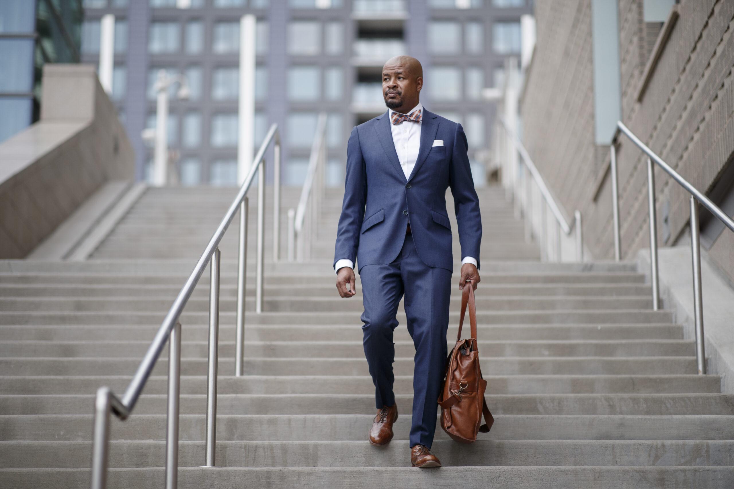 Alvin Cooper III in custom blue suit
